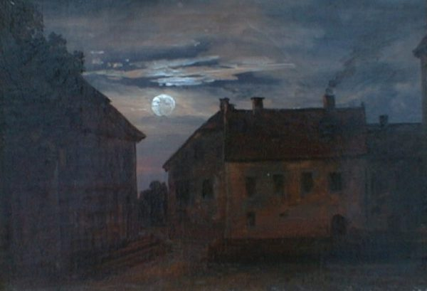 Old buildings in moonlight