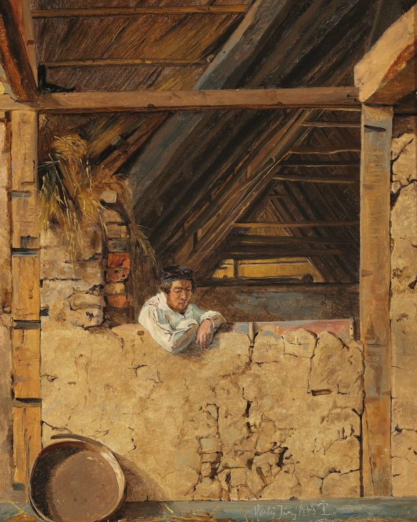 Peter Christian Skovgaard leaning against a low Wall in a Barn